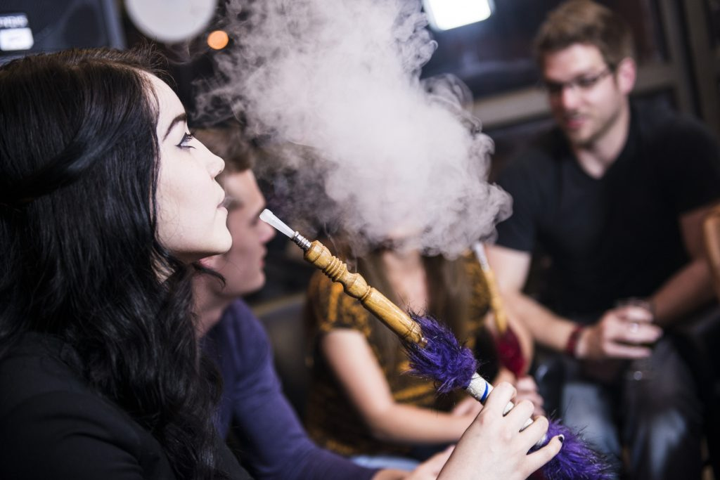 Friends Enjoy Smoking a Hookah